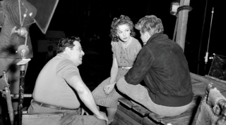 Director Archie Mayo with Ida Lupino and Jean Gabin on the set of Moontide