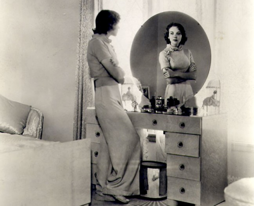 Ida Lupino at home in 1937, looking in a mirror